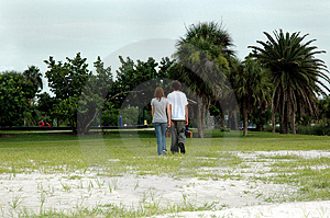 Teen Couple Walk In Park Royalty Free Stock Photo - Image: 1870725