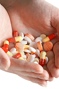 Heap of pills in two woman hands Royalty Free Stock Photo