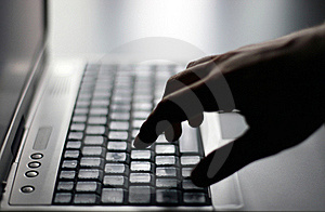 Hand on keyboard Royalty Free Stock Images