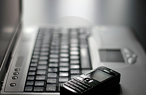 Keyboard and mobile phone Stock Images