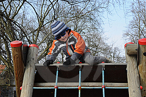 Boy Getting Over Barrier Royalty Free Stock Images - Image: 18713129