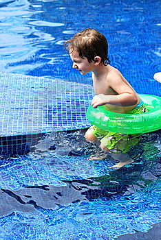 White Toddler Boy In A Pool With Tube Royalty Free Stock Photo - Image: 18717085