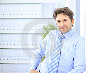 Young Businessman Standing In Office Stock Photos - Image: 18720483