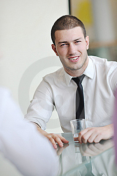 Young Business Man Alone In Conference Room Royalty Free Stock Photos - Image: 18727118