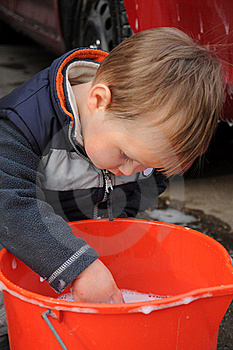 Boy Playing With Water Royalty Free Stock Photo - Image: 18770915
