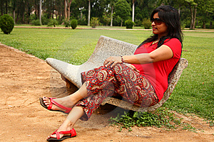Woman Sitting On Stone Bench In A Park Royalty Free Stock Photo - Image: 18779515