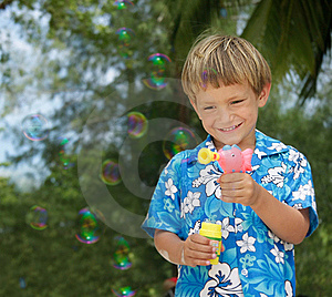 Boy Playing With Bubbles Stock Image - Image: 18784151
