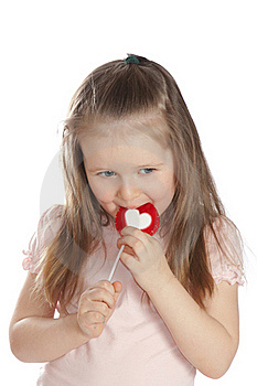 Little Girl Eating Candy  Lollipops Royalty Free Stock Images - Image: 18786209