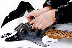 Person Tuning A Guitar Royalty Free Stock Photos - Image: 18788248