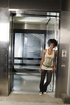 Walking out of elevator 02 Royalty Free Stock Photos
