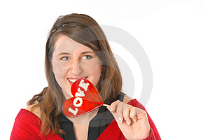 Smiling With Red Lollipop Stock Photo - Image: 1887750