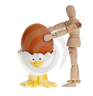 Wooden Man And Easter Egg On A Stand. Royalty Free Stock Photos - Image: 18808248