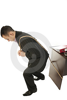 Businessman Pulling A Desk Royalty Free Stock Photography - Image: 18812227