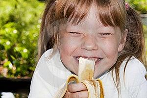 Little Girl Eats A Banana Royalty Free Stock Images - Image: 18824729