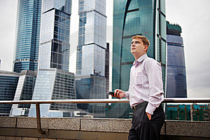 Man With Phone Against Backdrop Of City Stock Images - Image: 18840464