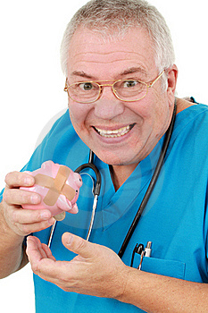 Man In Scrubs With A Piggy Bank Royalty Free Stock Photo - Image: 18868605
