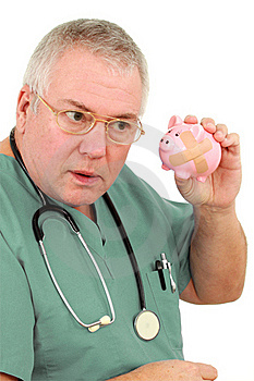 Man In Scrubs With A Piggy Bank Stock Image - Image: 18868611