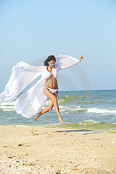 Girl Run On Coast Of A Sea Royalty Free Stock Images - Image: 18869829