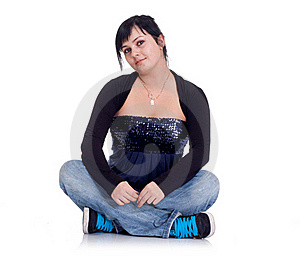 Girl In Jeans Sitting In The Lotus Position Royalty Free Stock Photography - Image: 18886217