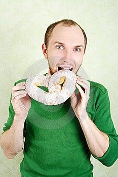 Man In Green Shirt Biting Big Cracknel Royalty Free Stock Photo - Image: 18895755