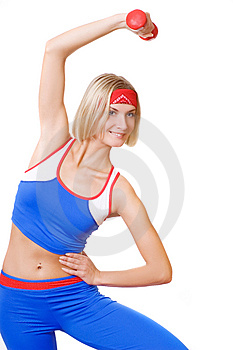 Blond girl with red dumbbell Stock Photos