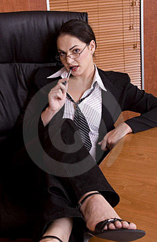 Business Woman Legs On Desk Royalty Free Stock Photo - Image: 1895165