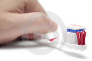 Holding a Toothbrush Stock Photo