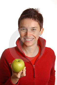Attractive Brunette With An Apple Royalty Free Stock Photography - Image: 1899727