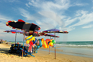 Stuff And Umbrella Against Blue Sea Royalty Free Stock Photography - Image: 18906107