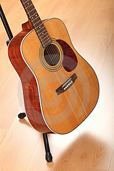 Brown Guitar On Neutral Background Royalty Free Stock Photography - Image: 18906707