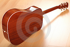 Brown Guitar On Neutral Background Stock Photos - Image: 18906753