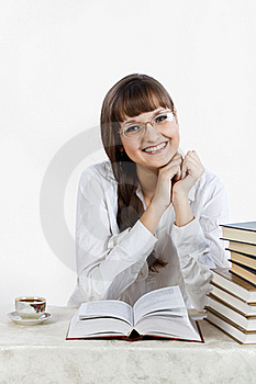 Beautiful Smiling Girl Reading A Book At The Table Stock Photography - Image: 18913732