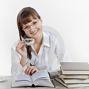 Smiling Girl Reading A Books And Drinking Coffee Stock Photography - Image: 18913742