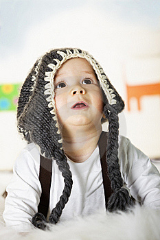 Baby Boy With Grey Cap Looking Up. Royalty Free Stock Photo - Image: 18922725
