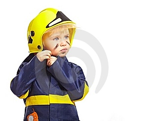 Boy In Fireman Costume With Helmet Royalty Free Stock Photography - Image: 18971647