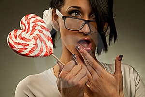 Woman With Heart Shaped Lollipop Royalty Free Stock Images - Image: 18976029