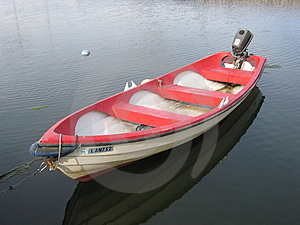 A Rowboat With A Motor Free Stock Image