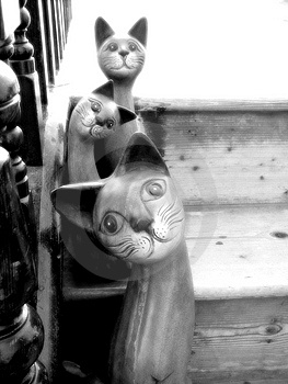 Wooden Cats on Stairs Royalty Free Stock Image