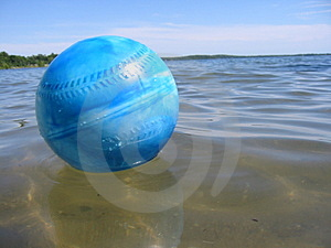Ball in water Stock Images
