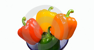 Four peppers in a bowl Royalty Free Stock Photos