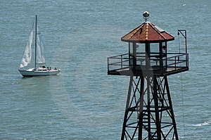 Tower and sailboat in ocean Royalty Free Stock Photography
