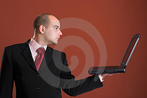 A Businessman with laptop Royalty Free Stock Image