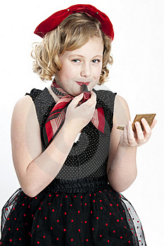 Little Girl Puts On Lipstick Royalty Free Stock Image - Image: 19007996