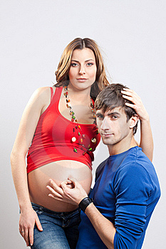Man Show Ok Sign On Pregnant Belly Royalty Free Stock Images - Image: 19045829