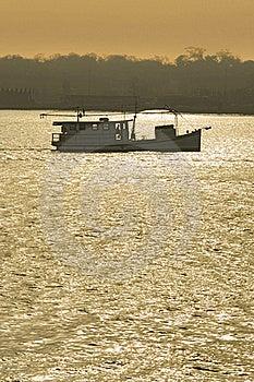 Fishing Boat Trawling At Sunset Royalty Free Stock Image - Image: 19051176