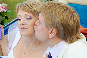 Bride And Groom Kissing In The Car Royalty Free Stock Image - Image: 19054136
