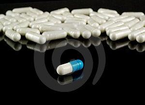 Pills Close-up On Black Reflective Backgroun Royalty Free Stock Photography - Image: 19090177