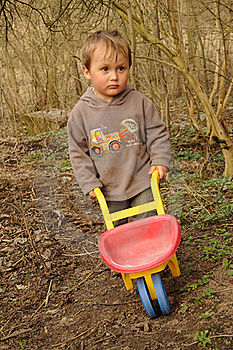 Boy With Wheelbarrow Royalty Free Stock Photo - Image: 19095485