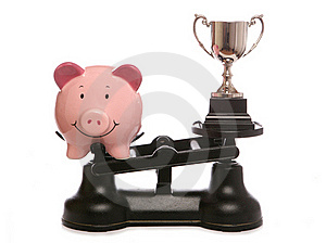 Piggy Bank Out Weighing Trophy Royalty Free Stock Images - Image: 19118369