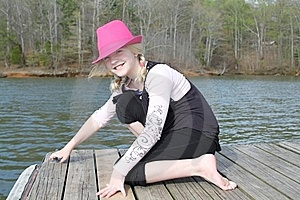 Girl On The Dock 2 Royalty Free Stock Photos - Image: 19120598